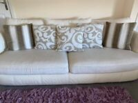 Cream Sofa And Cuddle Chair with cushions