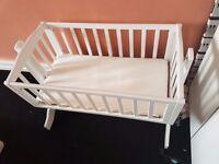 Swinging white crib