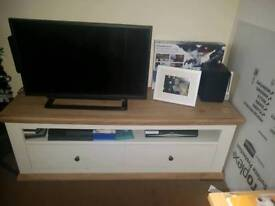 Wooden tv unit less then a year old