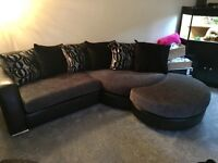 Gorgeous black and silver DFS corner sofa with matching stool and cuddle chair