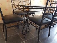 Wrought Iron Glass top Dining table c/w 6 chairs to match