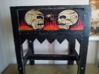 strange small spookie table with draw