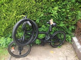 BMX bike , black, with 2 spare tyres, needs front brake cable