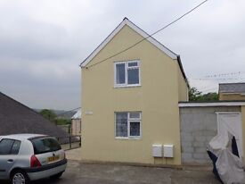 First floor flat. Goodwick. £380 P.C.M. Refurbished New carpets & Windows.Views over Fishguard Bay