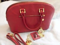 Joy and Iman red leather handbag with removable mirror and gold filigree watch
