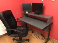 2 tier computer desk with black swivel office chair