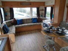 cheap static caravan includes fees quiet family woodland park open all year by the sea Devon