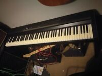 Korg SP 170s Electric Piano with weighted keys and including original stand