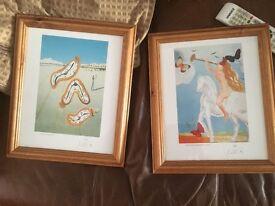 Two Salvador Dali prints in frames
