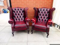 Pair of oxblood red leather chesterfield queen ann chairs