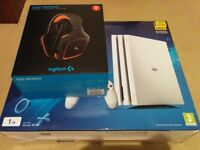 White PS4 Pro with logitech headset