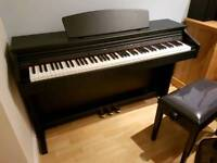 Broadway EZ102 piano for sale with Tiger piano stoo. Mint condition.