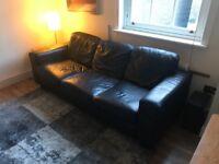 Black leather Ikea 3-seat sofa. Good condition.