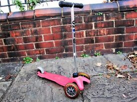 Mini Micro Scooter (slightly faded red). Good condition, approx 10 years old.