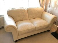 2 cream 2 seater leather sofas (not even 18months old)
