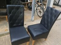 Set of 20 black leather chairs