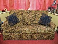 Three seater Wesley Barrell tapestry patterned sofabed. 170cm (L) x1m (D) x 1 m (H).