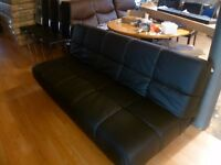 Thick Black Padded 3 seater sofa bed.
