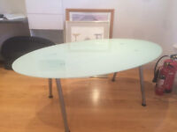 STYLISH OVAL GLASS OFFICE TABLE