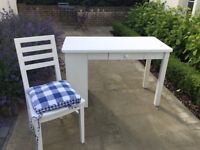 Pre-owned white Aspace desk with drawer and white chair with cushion.
