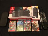 Nintendo Switch and 4 Games