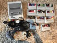 Mint condition snes with 2 controllers and some rare games.