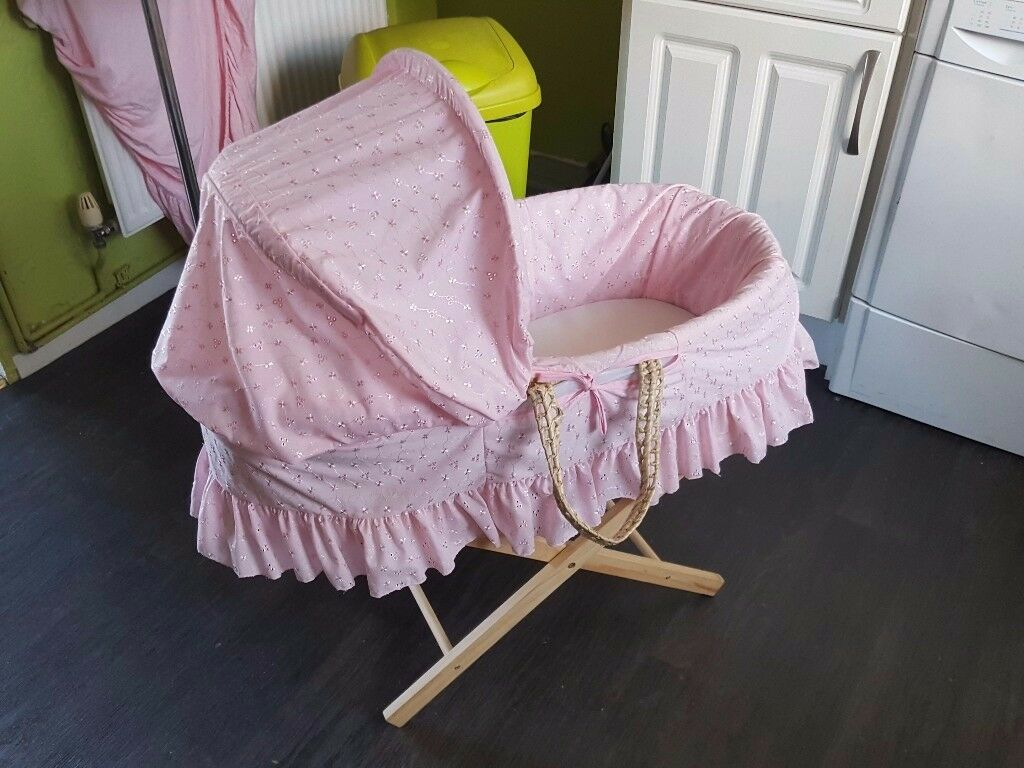 Baby girls pink moses basket