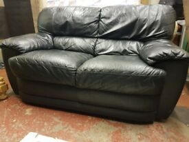 Black leather two seater sofa. FREE delivery in Derby.