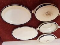 Cottage style serving dishes and plates