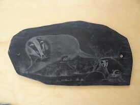 A badger sow and two cubs, a slate etching.