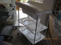 Baby changing station plus a GRACO carry cot both in very very good condition.