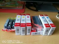 Unwanted ink carts for Canon printer, unused and sealed.