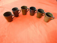 Handmade stoneware pottery mug. Hand crafted by Len Hurrell Green brown blue