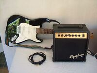 JIM DEACON ELECTRIC GUITAR AND AMPLIFIER . WITH BAG .