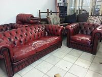 lovely 2 piece ox blood red leather Chesterfield. three setter and club chair.