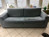 Natuzzi Sofa bed torn seat covers but otherwise in good functional condition