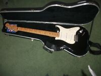 USA Stratocaster in black with white scatch plate includes original hard case