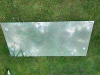 Modern glass top table oblong 58 in long 29 in wide