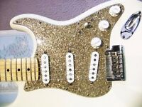 Genuine Fender Pickguard - Gold Aged Glass Sparkle - for USA/Mex Stratocaster.