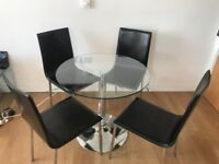 Round glass table and 4 faux leather chairs