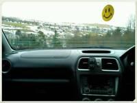 Subaru Impreza. ..low miles 98000