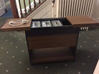 Heated electric trolley with glass dishes and hot cupboard