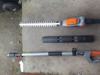 Battery powered long reach pole hedge cutters