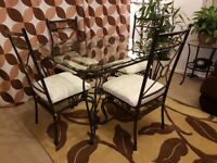 Glass dining table with 4 matching chairs