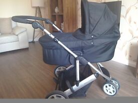 Mamas and papas Zoom pram set. Includes three wheel carrycot, stroller and rain cover.