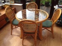 Conservatory dining set- glass topped table and 4 chairs. Excellent condition