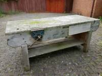 Large wooden work bench with vice