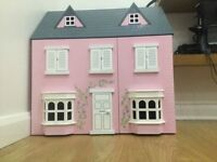 Wooden dolls house with furniture and dolls