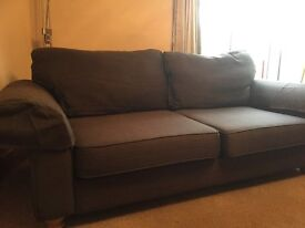 chocolate brown sofa made by DFS less than three years old seats three excellent condition