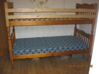Bunk Beds Pine with one mattress .No Ladder
